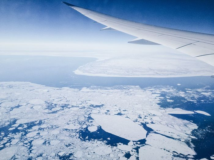 coast of Greenland, airplane view Greenland Ice Ice Floe Airplane Airplane Wing Arctic Beauty In Nature Bird's Eye View Climate Change Cold Temperature Day Environment Floe Ice Sheets Nature No People Outdoors Snow Tranquility Water Winter