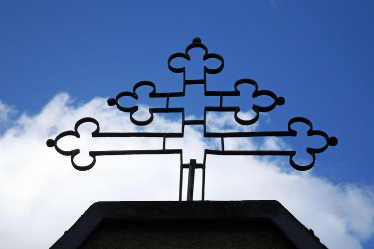 Metal cross in front of the church in Zagreb,Croatia,Europe Architectural Detail Catholicism Christianity Church Cloud - Sky Cross Day Europe Heaven In Front Low Angle View Metal Metallic Nature No People Outdoors Religion Sky Zagreb, Croatia