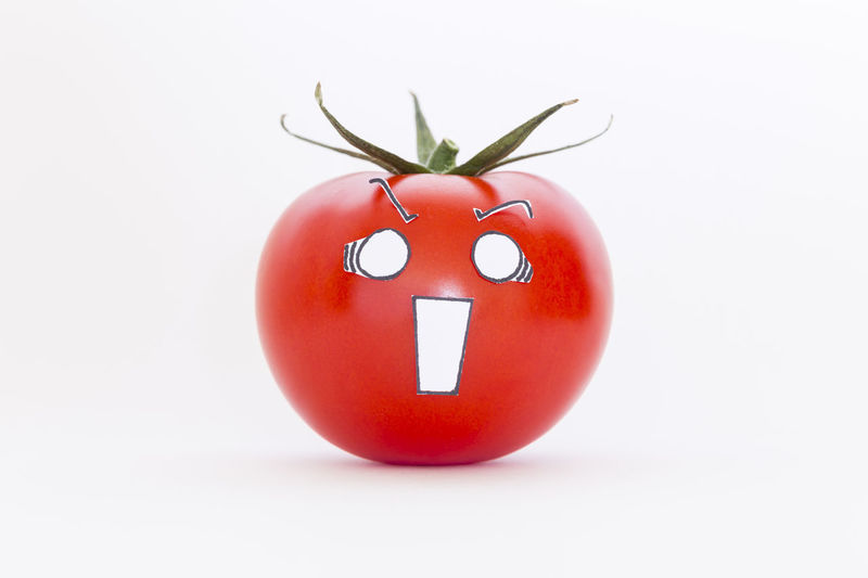 A single fresh red tomato with scared face in front of white background Anime Funny Panic Stress Cartoon Character Close-up Concept Crazy Delicious Emotion Face Food Fresh Freshness Illustration Juicy Kitchen Organic Red Scared Tomato Vegetable White Background Yummy