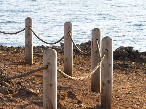 EyeEm Selects Sea Day Water Beach No People Summer Wooden Posts Rope Fence Sea Background Rocks And Sea Nature