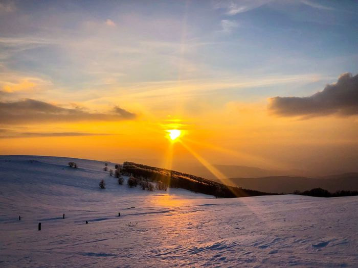Golden hour in winter in the mountains Idyllic Horizon WoodLand Tree Forest Mountain Range Mountain Reflection Sunrays Golden Hour Dusk Sunset Scenics - Nature Beauty In Nature Sky Tranquil Scene Tranquility Cloud - Sky Winter Snow Cold Temperature Orange Color Tranquility Sun Nature Non-urban Scene Sunlight No People Idyllic Outdoors