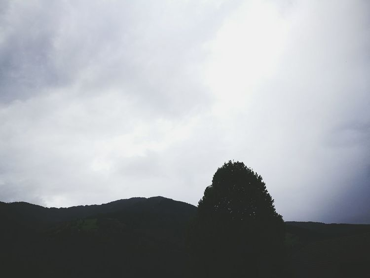 Tranquil Scene Scenics Tranquility Silhouette Mountain Sky Beauty In Nature Solitude Nature Remote Non-urban Scene Cloud Outdoors Day Mountain Range Majestic Cloud - Sky Outline No People High Section Eyeemphoto Color Palette