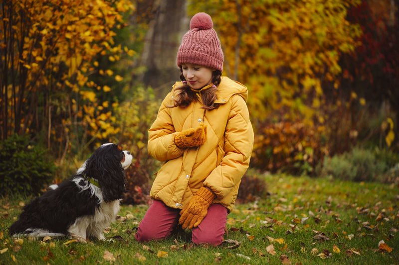 Full length of woman with dog during autumn