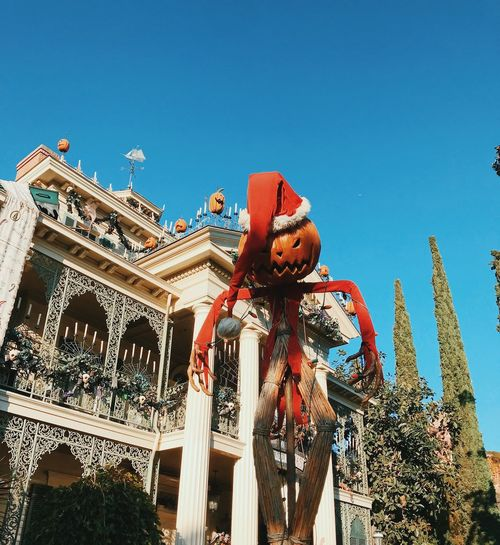 this is halloween Disneyland Jack Skellington Tim Burton Halloween Sky Low Angle View Built Structure Architecture Nature No People Clear Sky Building Exterior Day Arts Culture And Entertainment Outdoors Blue Christmas Travel Destinations