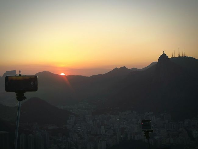 Selfıe Stick Sugarloaf Cristo Redentor Mobile Phone Action Cam Sunset Mountain Silhouette Sky Landscape Nature No People Outdoors Tranquility Travel Destinations Scenics Beauty In Nature City Day