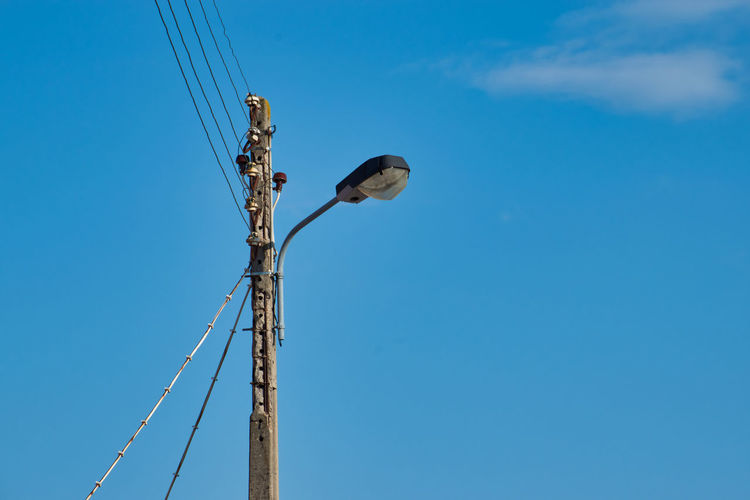 Electric wire poles Cable Connection Blue Sky Low Angle View Electricity  Power Supply Technology No People Day Nature Telephone Line Outdoors Clear Sky Electrical Equipment Copy Space Lighting Equipment Construction Equipment