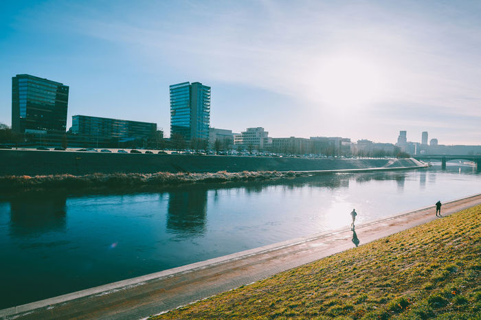 Runners Capture Tomorrow Europe Nikon Nikon Z7 Z7 Capital Vilnius Runners Leisure Activity Active Lifestyle  Architecture Building Exterior Built Structure Water City Sky Building Nature Urban Skyline Landscape Reflection Office Building Exterior Sunlight Outdoors River Cityscape Day No People Modern Skyscraper