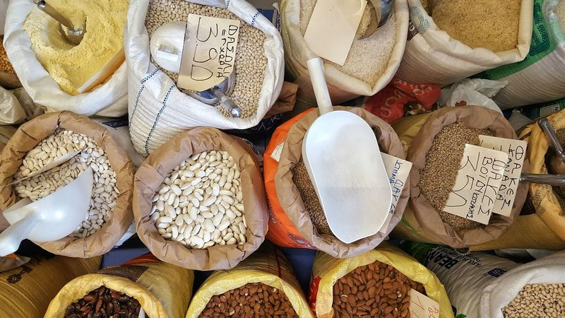 For Sale Market Sack Price Tag Food Retail  Choice Variation High Angle View Abundance Beans Pulses Powder Bags Scoop Greece Shop Stall Store Ingredients