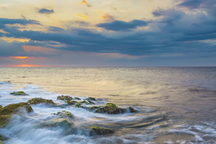 Sunday mood Water Sea Low Tide Sunset Wave Multi Colored Horizon Tide Seascape Coastline Rocky Coastline Rushing Horizon Over Water Shore Ocean Headland Calm Marram Grass Coast Romantic Sky Coastal Feature