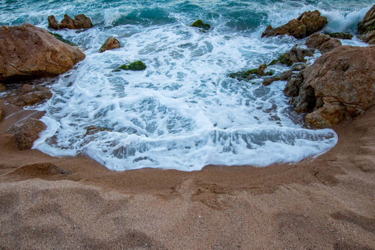 Waves breaking on rocks at shore