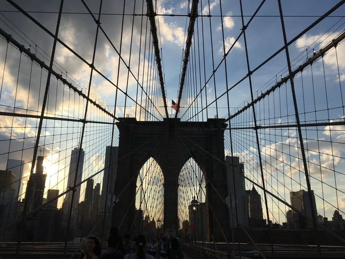 Low angle view of brooklyn bridge against sky in city