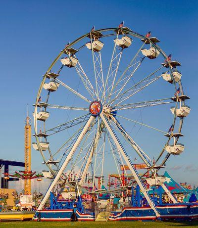 Carnival ride Amusement Park Ride Amusement Park Ferris Wheel Arts Culture And Entertainment Sky Low Angle View Clear Sky Fairground Shape Carnival Geometric Shape Fun Outdoors