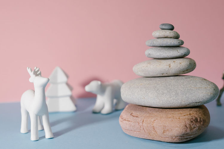 different Christmas tree Christmas Pink Polar Bear Reindeer Balance Blue Chess Chess Piece Christmas Tree Close-up Day Figurine  Indoors  Knight - Chess Piece No People Pebble Stack Still Life