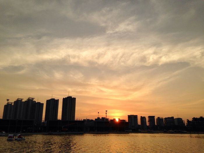 City in sunset. Sunset Water City Lake Muang Thong Thani Thailand Silhouette
