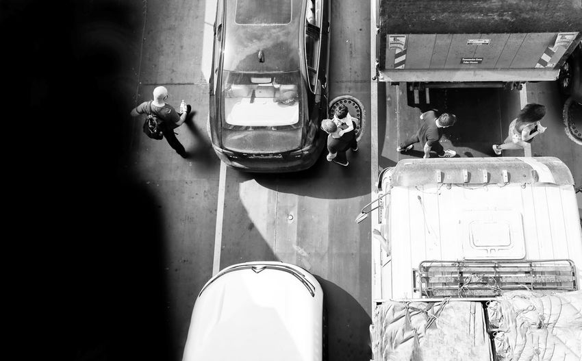 High angle view of people on car window