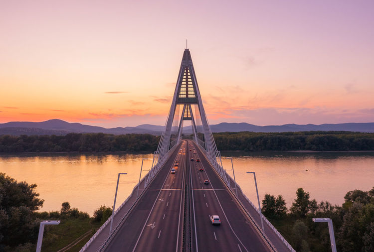 View of bridge over lake against sky during sunset