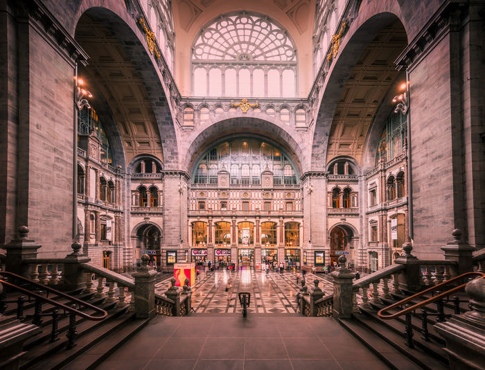 Remo SCarfo Antwerpen Belgium Stationary Central Station Architecture Arch Built Structure Real People Building Illuminated The Past Walking History Travel Destinations Travel Indoors  Adult People Lighting Equipment Women Railing Incidental People Men Architectural Column Ceiling