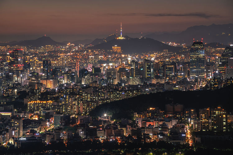 Seoul city skyline and seoul tower at night in Korea. Architecture Asia; Cityscape; Landmark; Business; Namsan; Beautiful; Winter; Life; Office; Capital Building Building Exterior Built Structure City Cityscape Community Crowded Financial District  Modern Nature Night Office Building Exterior Residential District Seoul; Korea; City; South; View; Skyline; Tower; Night; Sunset; Evening; Dark; Scenic; Culture; Asian; Mountain; Financial; Place; Destination; River; Tower Travel Destinations Travel; Architecture; Urban; Sky; Panorama; Downtown; District; Landscape; Modern; Aerial; Scene;