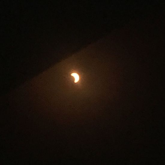 Took this through the eclipse glasses. Most amazing experience seeing this. Moon Night Nature Dark Astronomy No People Beauty In Nature Solar Eclipse Scenics Illuminated Outdoors Space Sky
