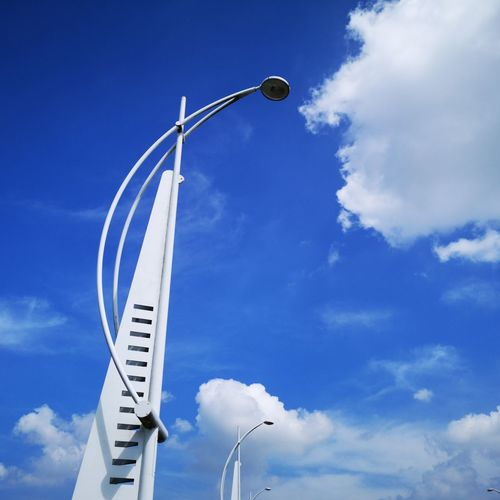 Lights against blue sky Light Street Light Street Lights Street Photography Urban Photography Blue Sky White Clouds Eyeem Clouds And Sky Clouds Clouds & Sky Blue And White Blue Sky Cloud - Sky Lighting Equipment Electric Light Lamp Post