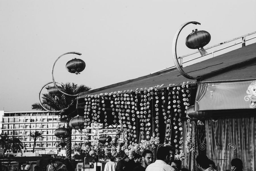 celebrating the new chinese year at cairo , egypt Adult Adults Only Black And White Blackandwhite Carnival Crowds And Details Celebration Chinese Lanterns Chinese New Year Crowd Day Festival Large Group Of People Lifestyles Outdoors People Real People Sky Street Photography Streetphotography