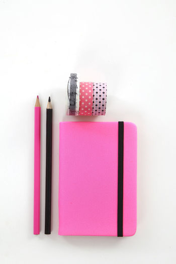 Close-up of pink pencils against white background