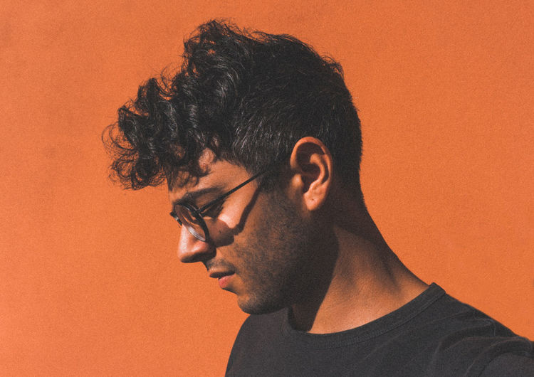 Orange is the New Black Glasses H&M Hair Background Beard Boy Casual Clothing Close-up Colored Background Contemplation Hairstyle Headshot Italian Lifestyles Men Model One Person Orange Background Outfit Portrait Profile View Real People Selfie Young Adult Young Men