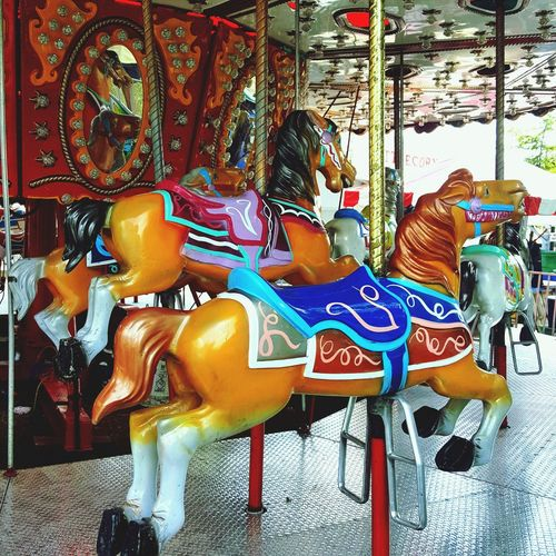 Fun at any age ,.... Carousel Merry-go-round Amusement Park Ride Arts Culture And Entertainment Carousel Horses Amusement Park Multi Colored Horse Close-up