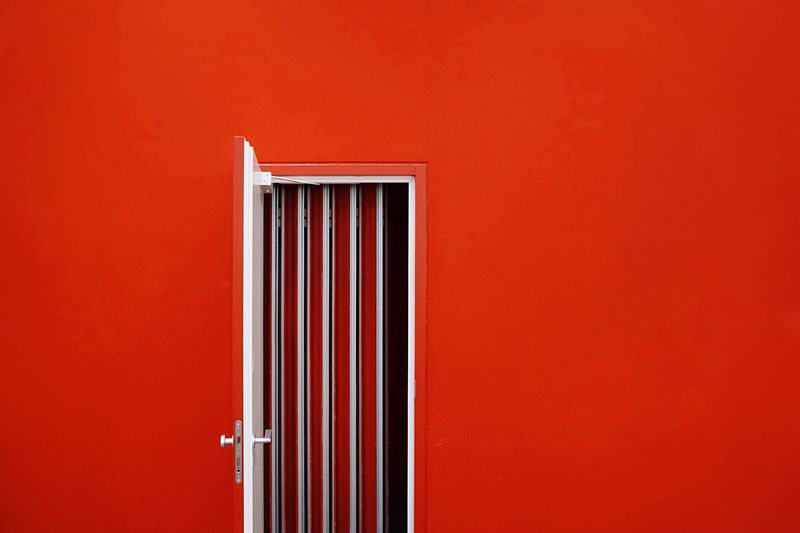 Door On Red Wall