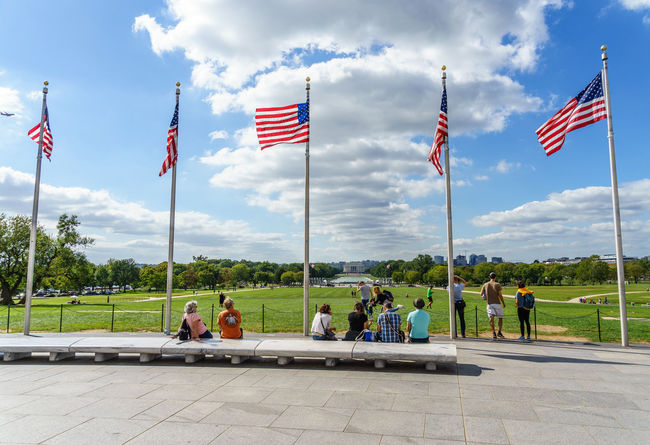 Alrington Cloud Cloud - Sky District Of Columbia Flag Full Length Honor Guard Identity International Landmark Leisure Activity Lifestyles Memorial Men National Flag Old Guard Patriotism Person Sightseeing Sitting Sky Vietnam Trip Walking Washington Washington, D. C. Water
