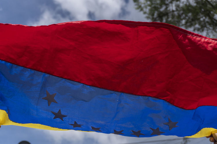 Red Textile Flag Sky Patriotism Blue Low Angle View No People Nature Day Wind Environment Cloud - Sky White Color Close-up Outdoors Star Shape Shape Hanging Venezuela VenezuelaSomosTodos