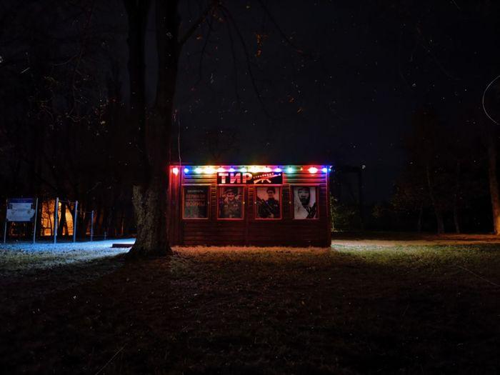 Illuminated street light on field at night