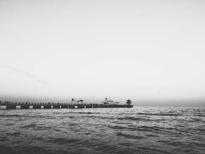 Scenic view pier against cloudy sky