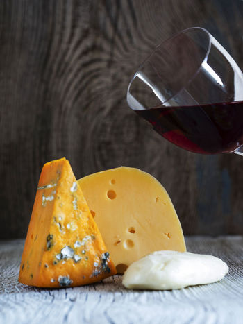 Fresh pieces of cheese (Mozzarella, roquefort, Maasdam) and wine on old wooden weathering background Background Baked Cheese Close-up Cultures Food French Food Fresh Freshness Maasdam Mozzarella No People Old Pieces Roquefort Sweet Pie Table Weathering Wine Wooden