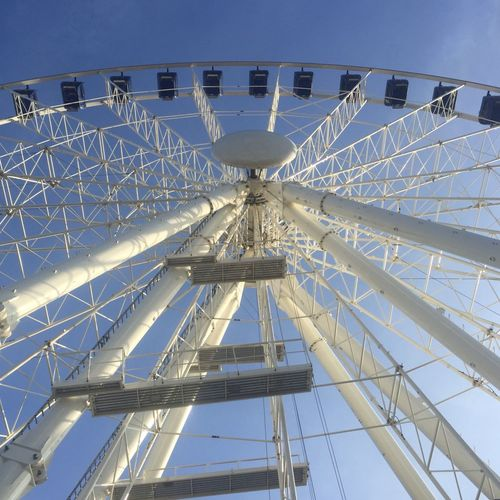 Low Angle View Of White Ferris Wheel At Park Against Sky