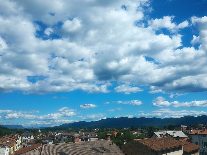 Amazing light blue sky from my room! Architecture Beauty In Nature Blue Building Exterior Built Structure City Cityscape Cloud Cloud - Sky Cloudy Day Landscape Mountain Mountain Range Nature No People Outdoors Residential Building Residential District Residential Structure Roof Scenics Sky Town TOWNSCAPE