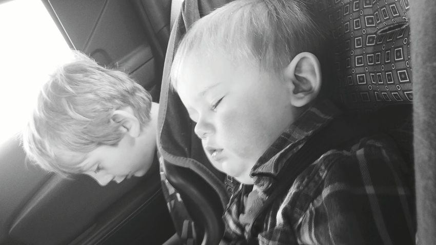 Showcase: February Sleeping Black & White Child Adorable Car Ride  Cousin Cousins  Baby Toddler  The Portraitist - 2016 EyeEm Awards