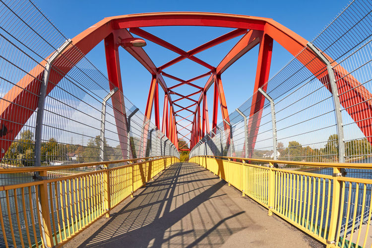 footbridge Footbridge Architecture Barrier Bridge Bridge - Man Made Structure Built Structure Clear Sky Connection Day Engineering Fence Footbridge Metal Nature Outdoors Railing Shadow Sky Sunlight Suspension Bridge The Way Forward Transportation