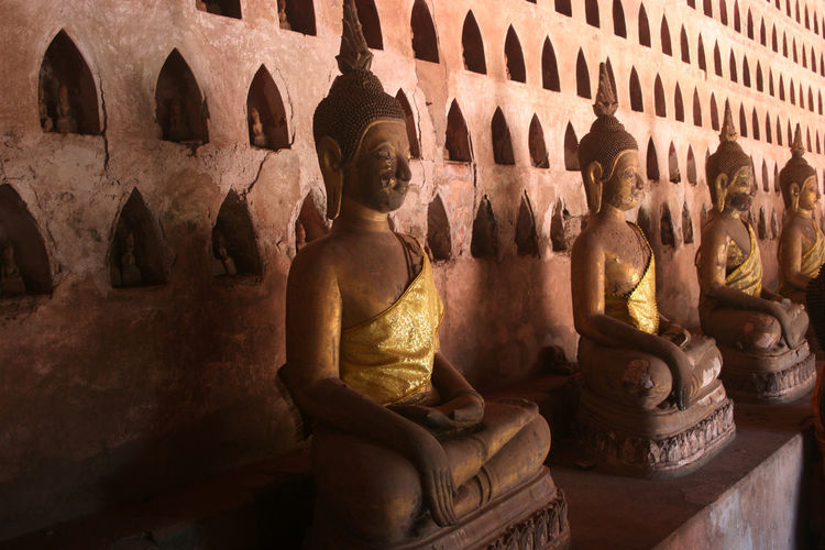 Row of Buddah statues. Vientiane, Laos. Vientiane, Laos Ancient Civilization Buddah Statue Built Structure Day History Human Representation Indoors  Male Likeness No People Old Ruin Religion Sculpture Spirituality Statue Tourism Travel Destinations