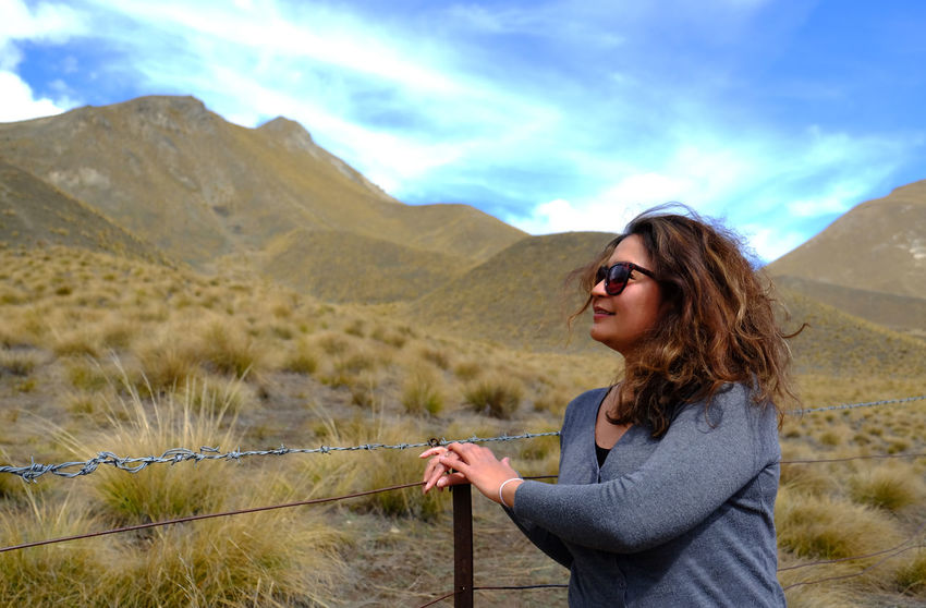 One Person Mountain Leisure Activity Sky Lifestyles Adult Beauty In Nature Nature Women Tranquil Scene Standing Mountain Range Tranquility Hairstyle Outdoors Desert Dramatic Sky Dry Terrain Females Autumn Fall Season  Sunny Attractive Foresight