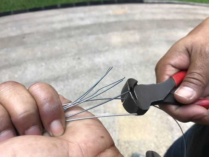 Close-up of man holding tool