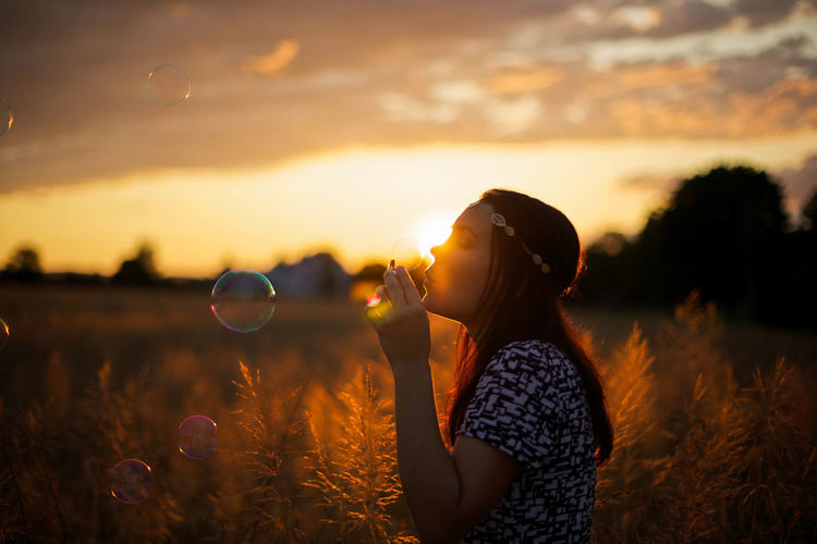 Backlight Beautiful Beauty In Nature Bubbles Evening Sky Feelings Field Fields Freedom Goldenhour Happiness Joy One Person Outdoors Silhouette Sky Soap Bubbles Sunset Young Women