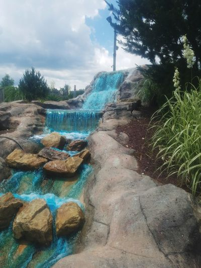 Manmade waterfall Water Nature Tree Outdoors Sky Waterfall Manmade Waterfall Rocks Blue Water