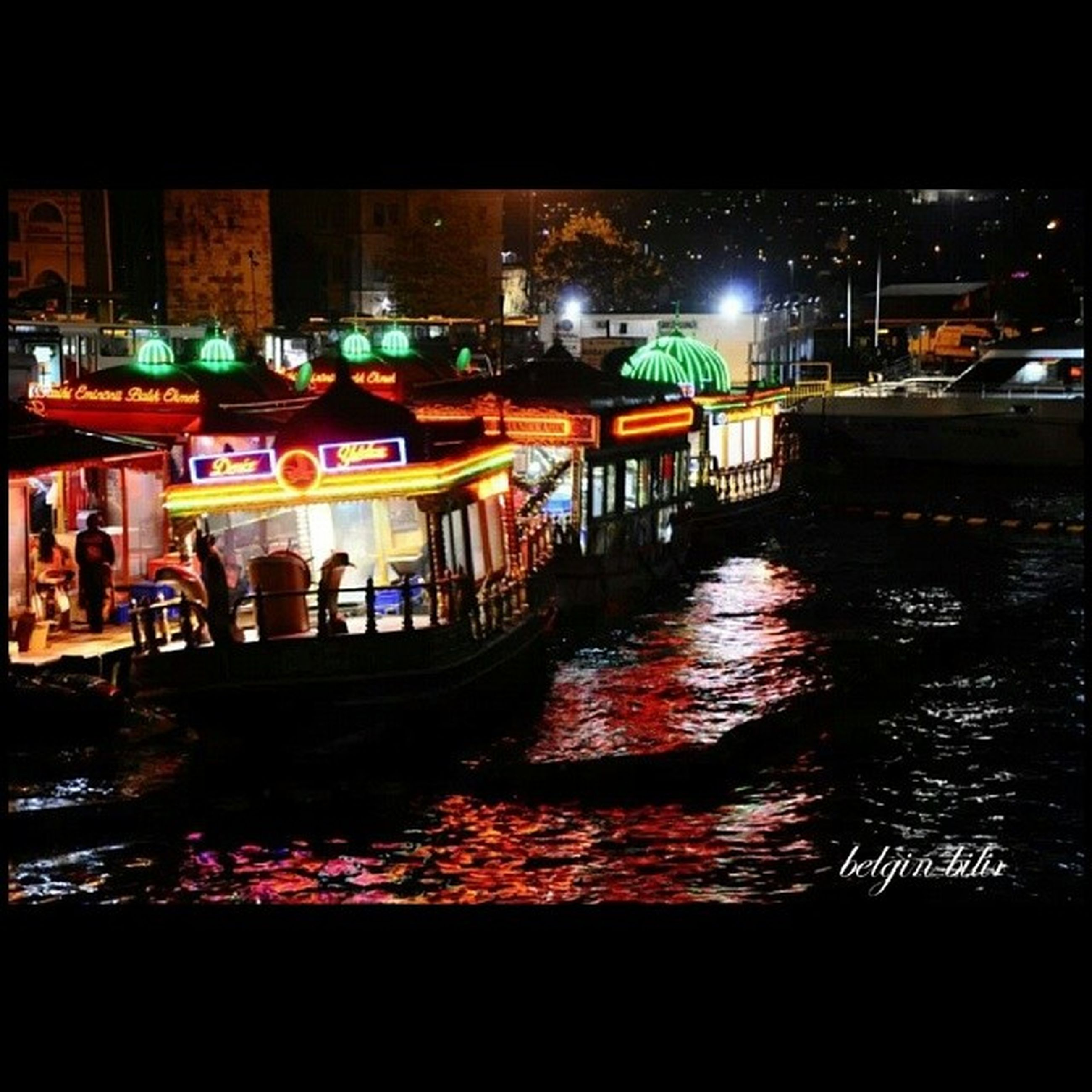 night, illuminated, built structure, architecture, building exterior, water, transportation, mode of transport, nautical vessel, city, men, river, reflection, waterfront, street light, city life, incidental people, outdoors, lighting equipment