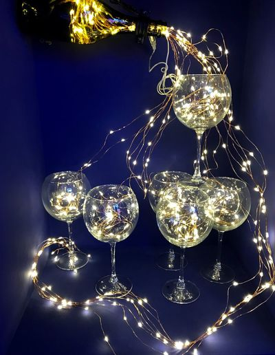Low angle view of illuminated lights on glass table