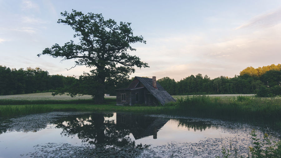 Old sauna Sauna Architecture Beauty In Nature Building Exterior Built Structure Cloud - Sky Day Growth History Lake Nature No People Outdoors Reflection Scenics Sky Tranquil Scene Tranquility Tree Water Watermill