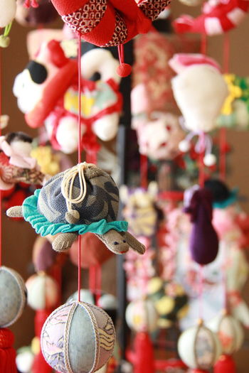 Close-up of stuffed toy hanging for sale in market