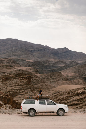 Side view of a car on desert