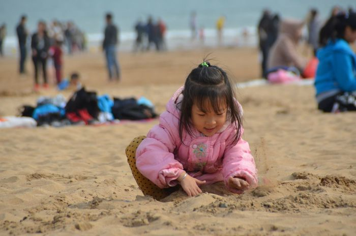 EyeEm Selects Sand Beach Incidental People Real People Focus On Foreground Childhood Full Length Girls Lifestyles Day Outdoors Sand Pail And Shovel People