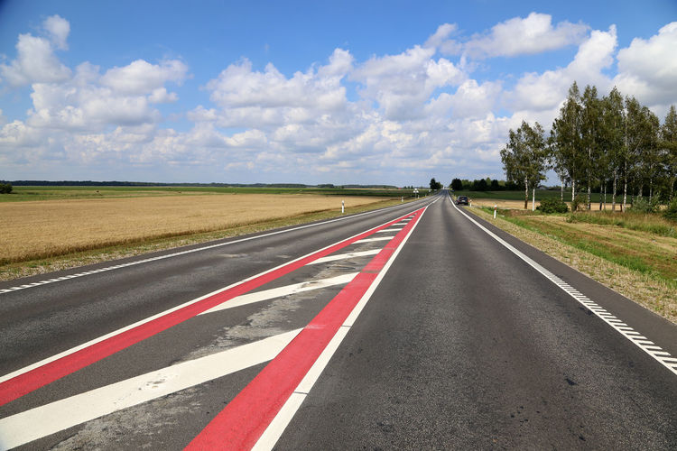 Surface Level Of Road Along Countryside Landscape